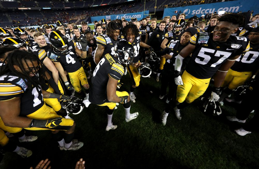 Iowa Hawkeyes wide receiver Ihmir Smith-Marsette (6) dances as they celebrate their win against USC in the Holiday Bowl Friday, December 27, 2019 at San Diego Community Credit Union Stadium.  (Brian Ray/hawkeyesports.com)