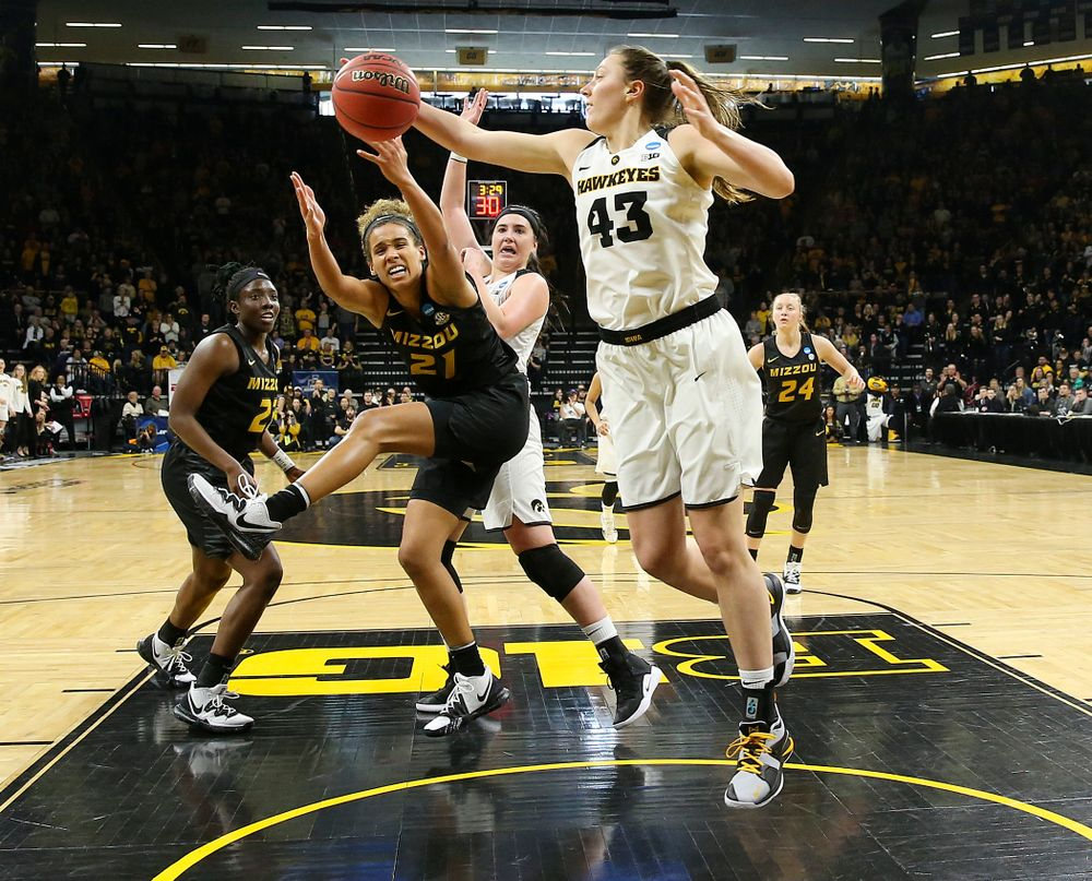 Iowa Hawkeyes forward Amanda Ollinger (43) pulls in a rebound during the second quarter of their second round game in the 2019 NCAA Women's Basketball Tournament at Carver Hawkeye Arena in Iowa City on Sunday, Mar. 24, 2019. (Stephen Mally for hawkeyesports.com)
