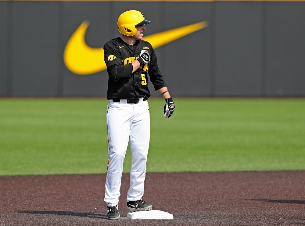 Iowa Hawkeyes first baseman Zeb Adreon (5) celebrates as he stands on second base after hitting an RBI double during the fourth inning of their game against Rutgers at Duane Banks Field in Iowa City on Saturday, Apr. 6, 2019. (Stephen Mally/hawkeyesports.com)