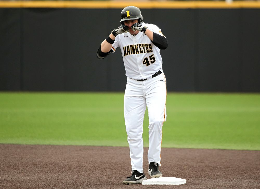 Iowa first baseman Peyton Williams (45) celebrates on second base after hitting a double during the first inning of their college baseball game at Duane Banks Field in Iowa City on Wednesday, March 11, 2020. (Stephen Mally/hawkeyesports.com)