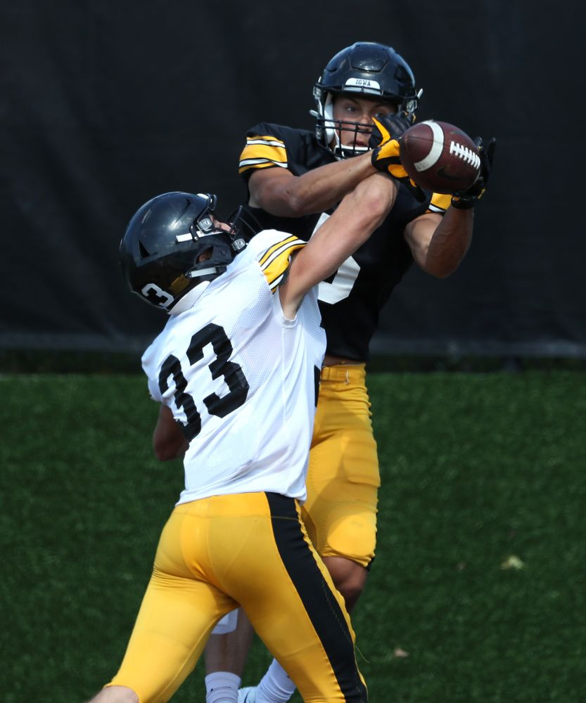 Iowa Hawkeyes defensive back Riley Moss (33) and wide receiver Oliver Martin (5) during Fall Camp Practice No. 5 Tuesday, August 6, 2019 at the Ronald D. and Margaret L. Kenyon Football Practice Facility. (Brian Ray/hawkeyesports.com)