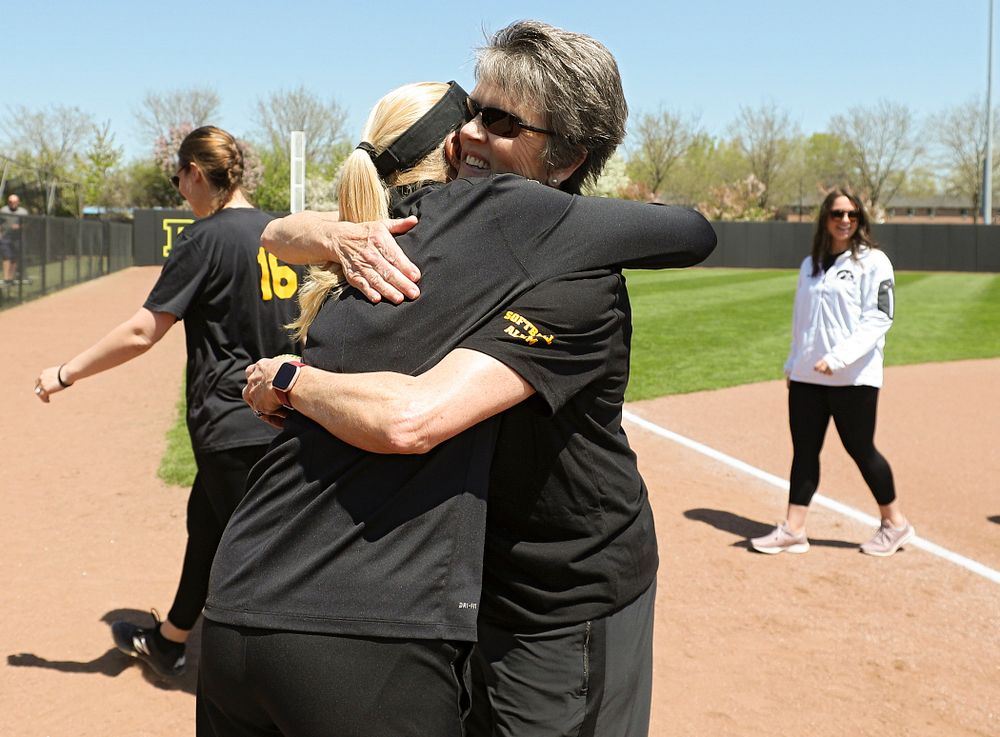 Former Iowa head coach Gayle Blevins (right) gives current head coach Renee Gillispie a hug before the game against Ohio State at Pearl Field in Iowa City on Saturday, May. 4, 2019. (Stephen Mally/hawkeyesports.com)