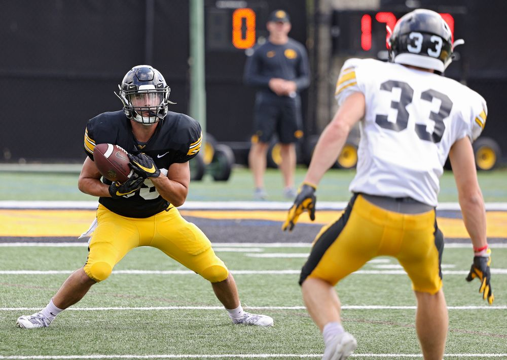 Iowa Hawkeyes wide receiver Nico Ragaini (89) pulls in a punt as defensive back Riley Moss (33) closes in during Fall Camp Practice No. 11 at the Hansen Football Performance Center in Iowa City on Wednesday, Aug 14, 2019. (Stephen Mally/hawkeyesports.com)