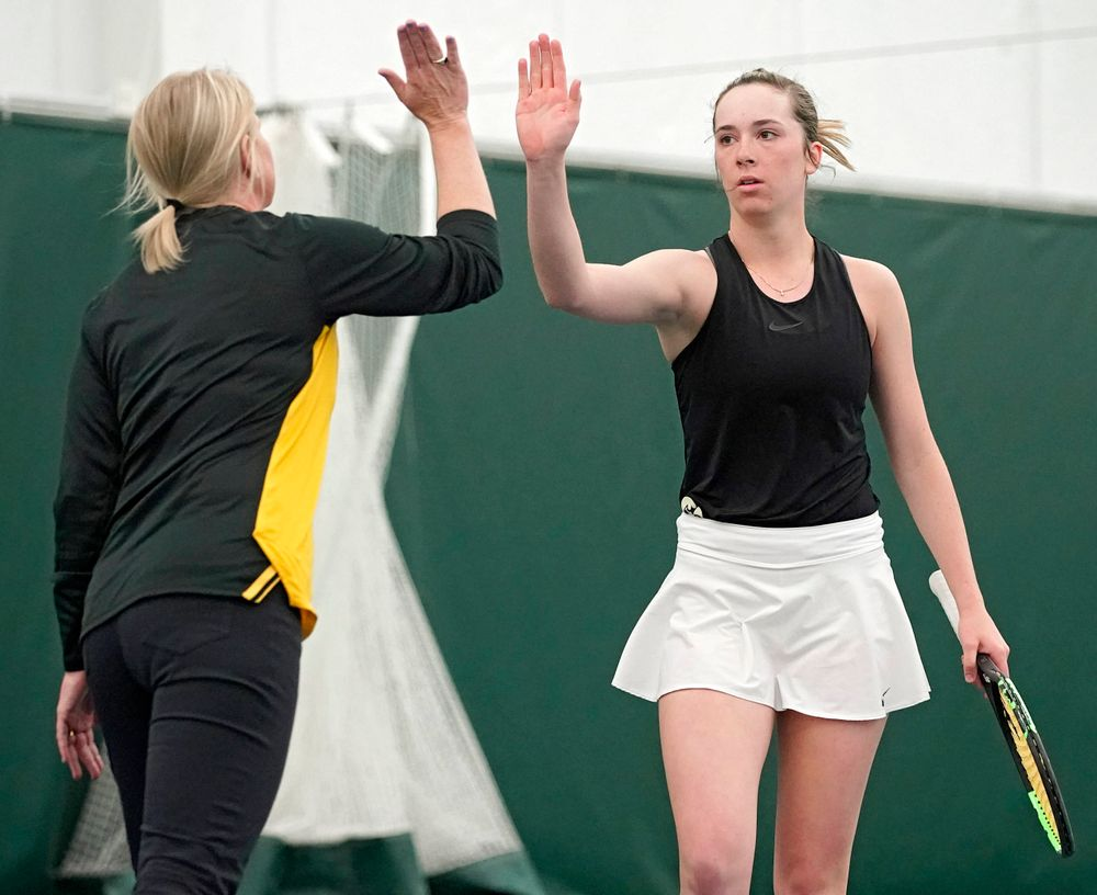 Iowa head coach Sasha Schmid gives a high-five to Samantha Mannix during a match against Indiana at the Hawkeye Tennis and Recreation Complex in Iowa City on Sunday, Mar. 31, 2019. (Stephen Mally/hawkeyesports.com)