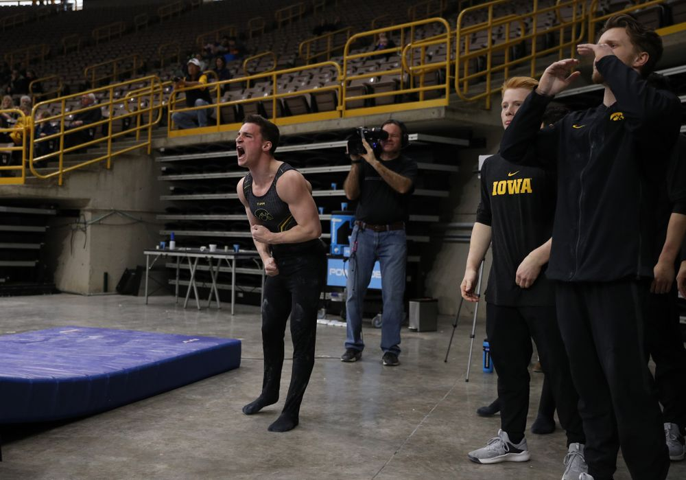 Iowa's Jake Brodarzon cheers on his teammates during their meet against the Ohio State Buckeyes Saturday, March 16, 2019 at Carver-Hawkeye Arena.  (Brian Ray/hawkeyesports.com)