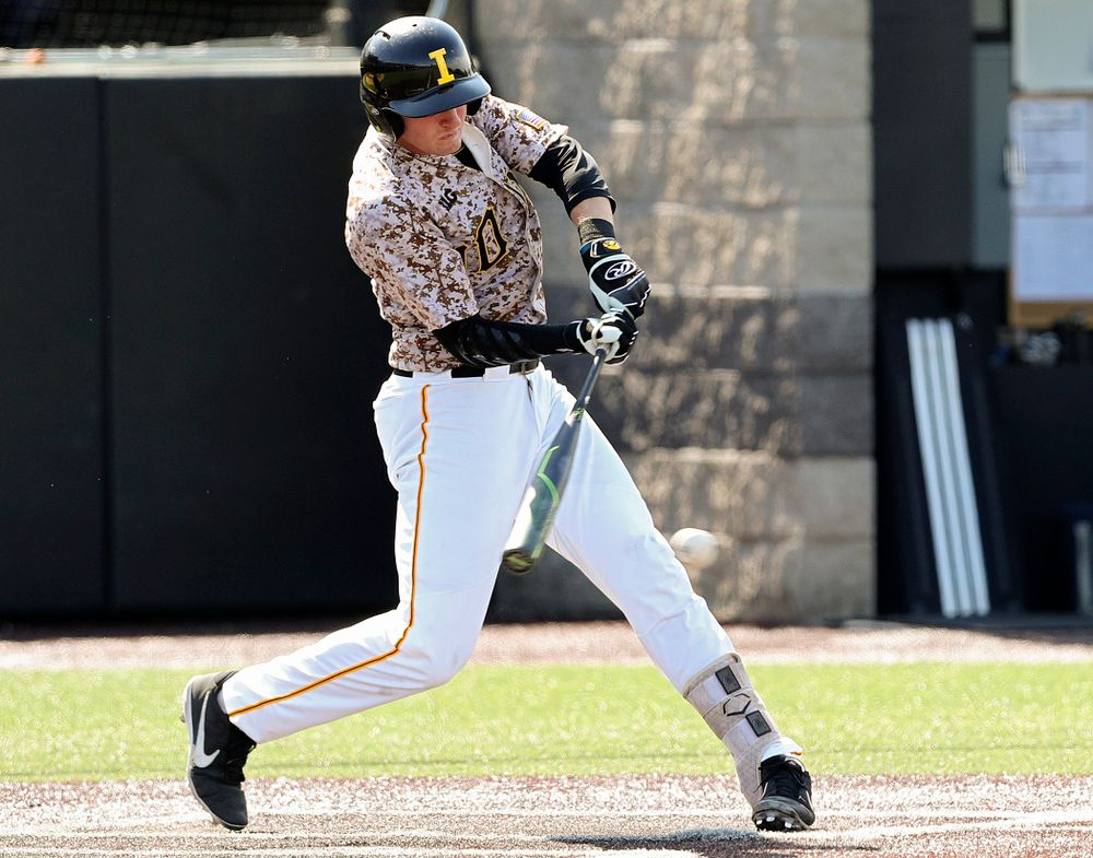 Iowa Hawkeyes third baseman Brendan Sher (2) drives a pitch for a hit during the seventh inning of their game against UC Irvine at Duane Banks Field in Iowa City on Sunday, May. 5, 2019. (Stephen Mally/hawkeyesports.com)