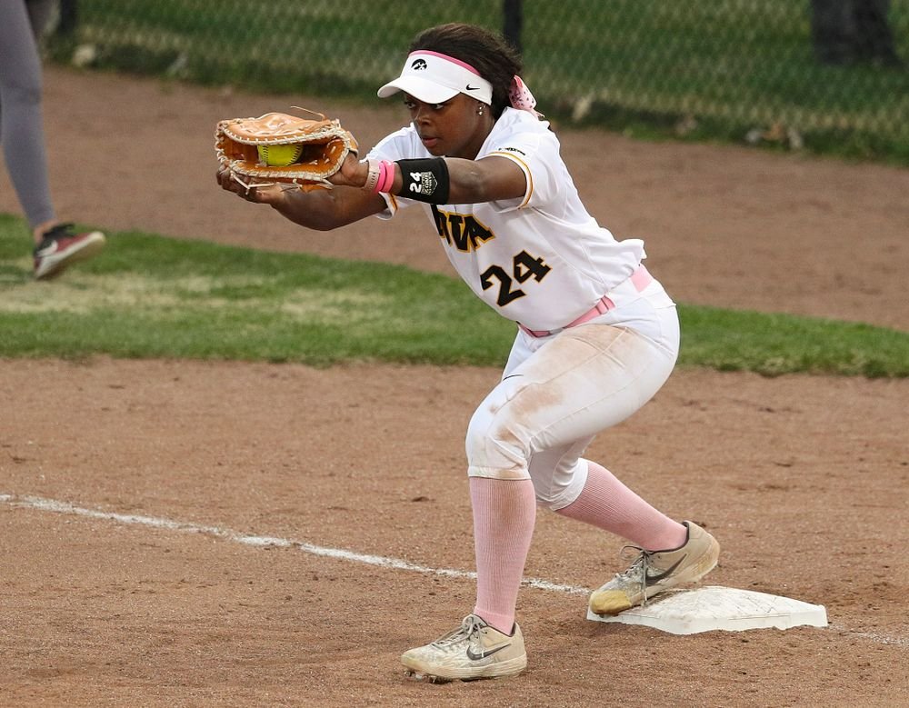 Iowa first baseman DoniRae Mayhew (24) pulls in a throw for an out during the third inning of their game against Iowa State at Pearl Field in Iowa City on Tuesday, Apr. 9, 2019. (Stephen Mally/hawkeyesports.com)