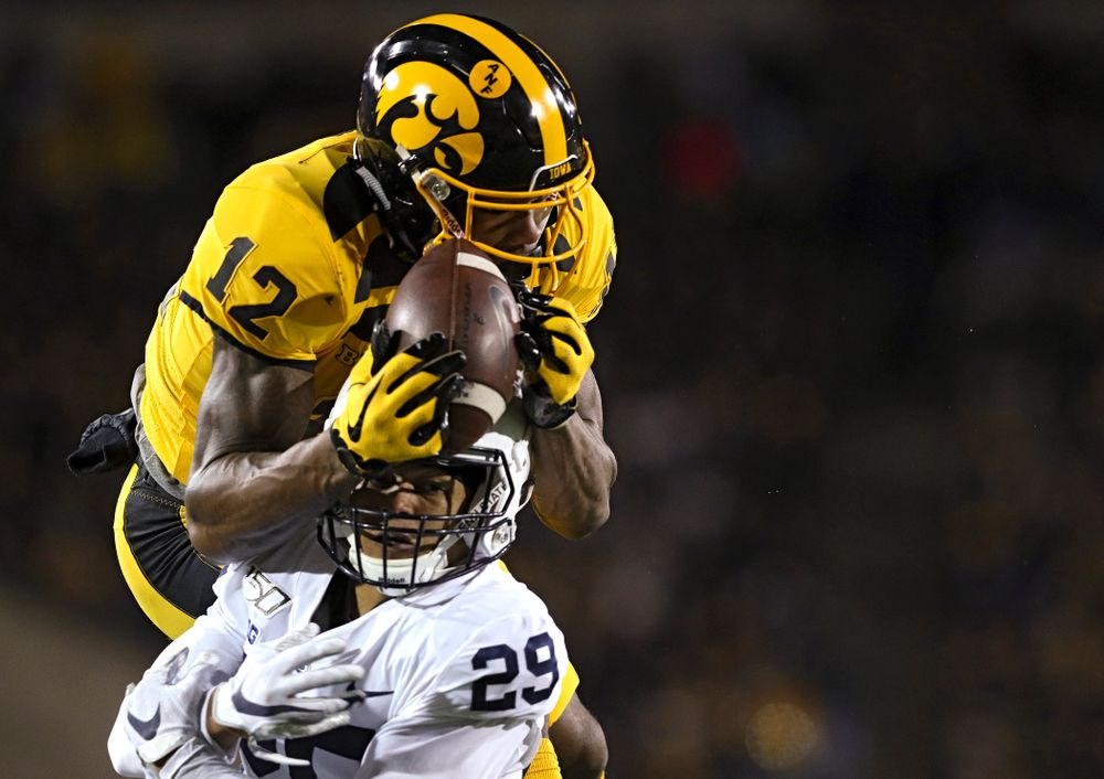 Iowa Hawkeyes wide receiver Brandon Smith (12) pulls in a touchdown pass over Penn State Nittany Lions cornerback John Reid (29) during the fourth quarter of their game at Kinnick Stadium in Iowa City on Saturday, Oct 12, 2019. (Stephen Mally/hawkeyesports.com)