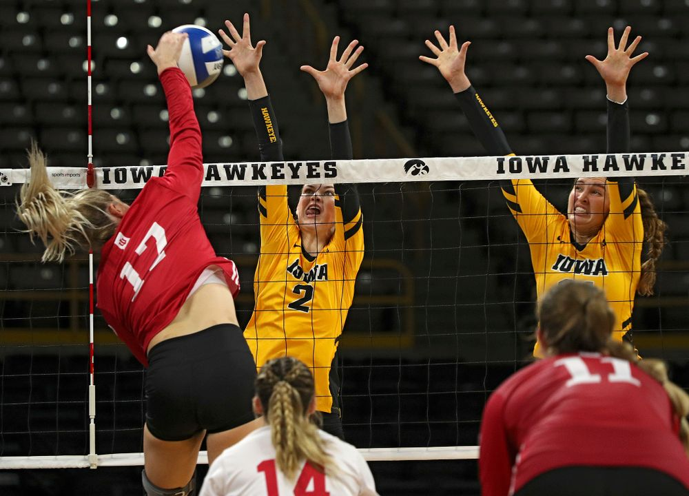 Iowa's Courtney Buzzerio (2) and Blythe Rients (11) try for a block during their match at Carver-Hawkeye Arena in Iowa City on Sunday, Oct 20, 2019. (Stephen Mally/hawkeyesports.com)