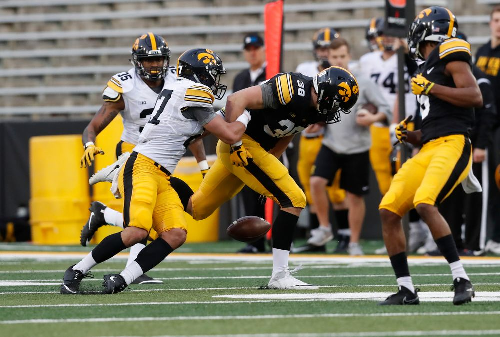 Iowa Hawkeyes tight end T.J. Hockenson (38) and defensive back Amani Hooker (27) during the final spring practice Friday, April 20, 2018 at Kinnick Stadium. (Brian Ray/hawkeyesports.com)