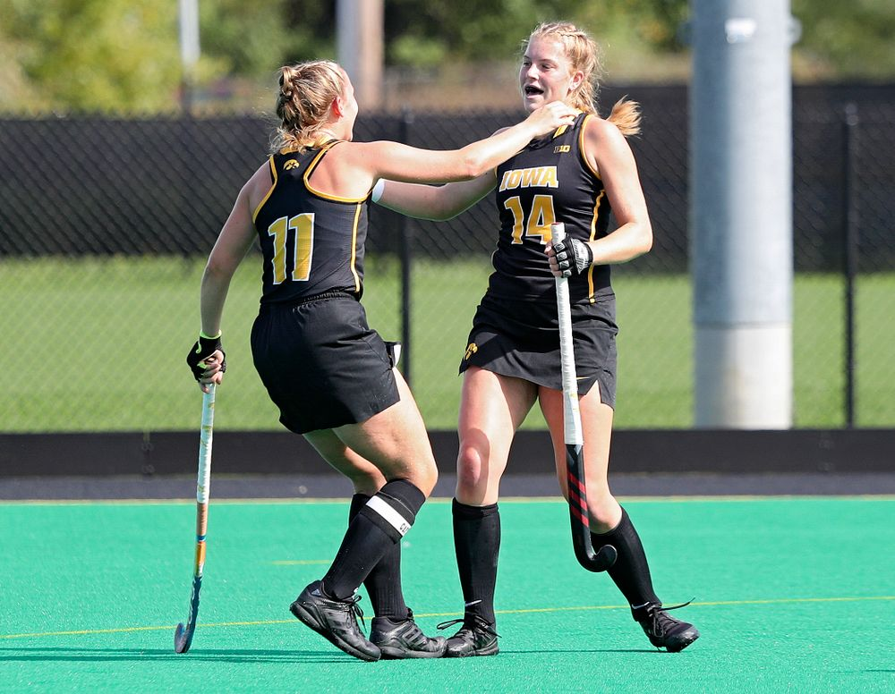 Iowa's Lokke Stribos (14) celebrates with Katie Birch (11) after Stribos scored a goal during the first quarter of their match at Grant Field in Iowa City on Friday, Oct 4, 2019. (Stephen Mally/hawkeyesports.com)