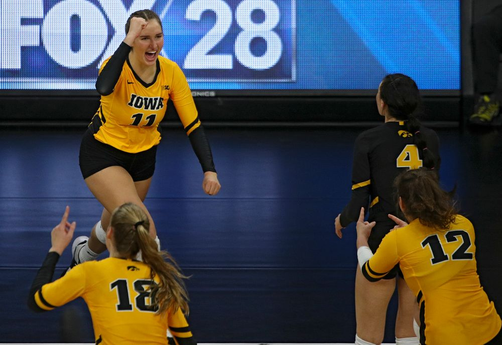 Iowa's Blythe Rients (11) celebrates her kill during the second set of their match against Illinois at Carver-Hawkeye Arena in Iowa City on Wednesday, Nov 6, 2019. (Stephen Mally/hawkeyesports.com)
