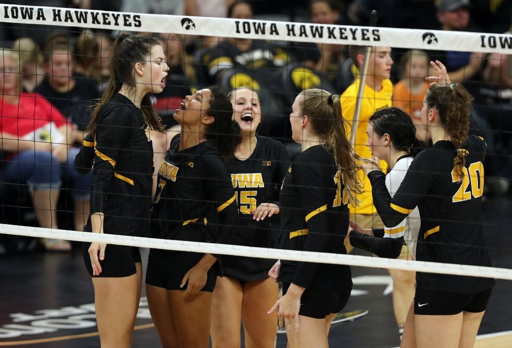Iowa Hawkeyes setter Courtney Buzzerio (2) celebrates a kill with setter Brie Orr (7) against the Iowa State Cyclones Saturday, September 21, 2019 during the Iowa Corn Cy-Hawk Series Tournament at Carver-Hawkeye Arena. (Brian Ray/hawkeyesports.com)