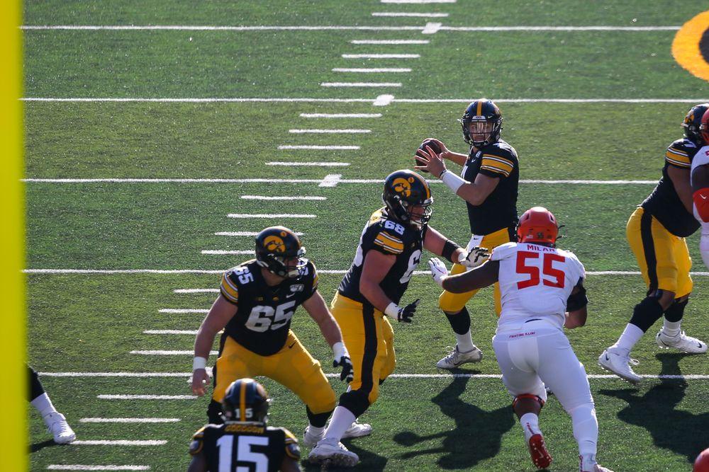 Iowa Hawkeyes quarterback Nate Stanley (4) and Iowa Hawkeyes offensive lineman Landan Paulsen (68) during Iowa football vs Illinois on Saturday, November 23, 2019 at Kinnick Stadium. (Lily Smith/hawkeyesports.com)