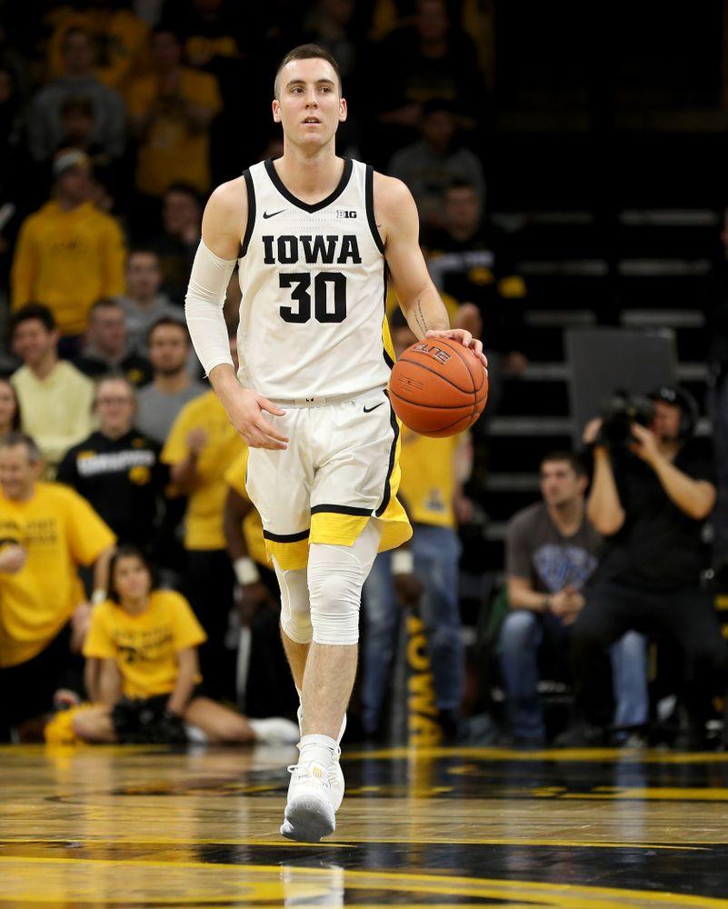 Iowa Hawkeyes guard Connor McCaffery (30) Iowa Hawkeyes guard CJ Fredrick (5) against the Michigan Wolverines Friday, January 17, 2020 at Carver-Hawkeye Arena. (Brian Ray/hawkeyesports.com)