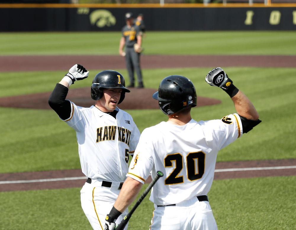 Iowa Hawkeyes catcher Tyler Cropley (5) celebrates with catcher Austin Guzzo (20) after hitting a home run against the Missouri Tigers Tuesday, May 1, 2018 at Duane Banks Field. (Brian Ray/hawkeyesports.com)