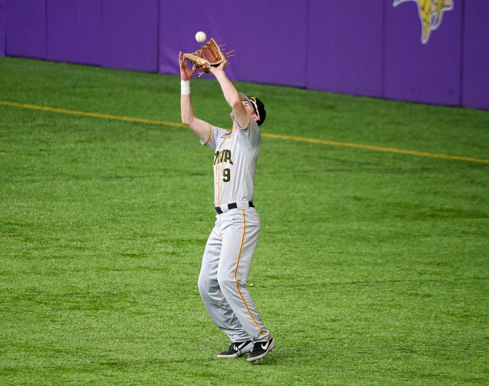 Iowa Hawkeyes outfielder Ben Norman (9) pulls in a fly ball for an out during the second inning of their CambriaCollegeClassic game at U.S. Bank Stadium in Minneapolis, Minn. on Friday, February 28, 2020. (Stephen Mally/hawkeyesports.com)