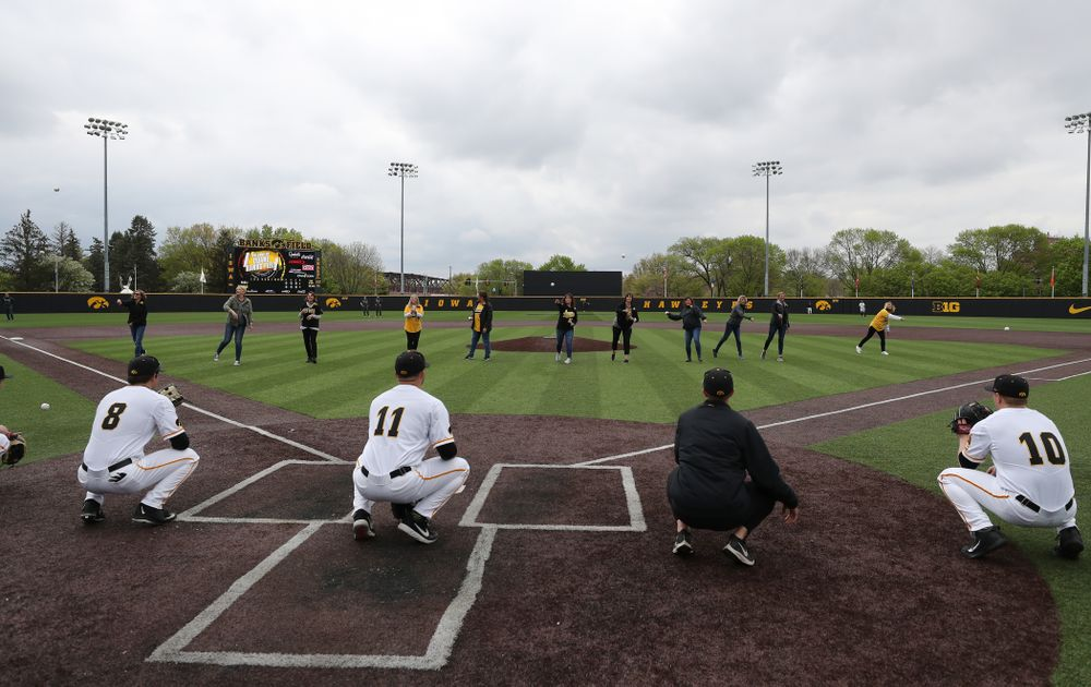 The senior moms throw out a first pitch before their game against Michigan State Sunday, May 12, 2019 at Duane Banks Field. (Brian Ray/hawkeyesports.com)