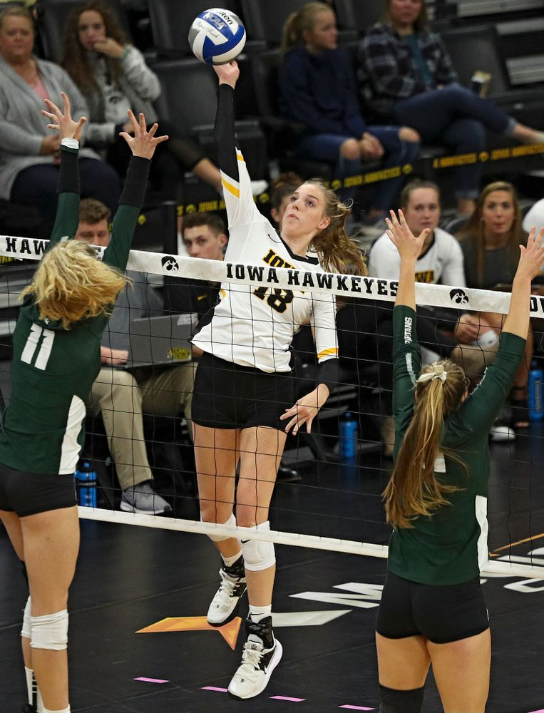 Iowa's Hannah Clayton (18) lines up a shot during the first set of their volleyball match at Carver-Hawkeye Arena in Iowa City on Sunday, Oct 13, 2019. (Stephen Mally/hawkeyesports.com)