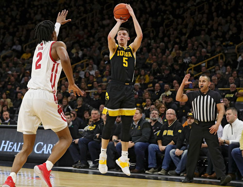 Iowa Hawkeyes guard CJ Fredrick (5) makes a 3-pointer during the first half of their game at Carver-Hawkeye Arena in Iowa City on Monday, January 27, 2020. (Stephen Mally/hawkeyesports.com)