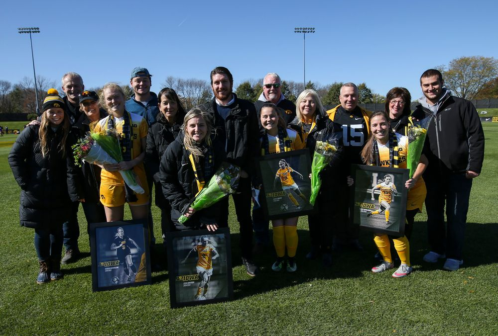 Senior members of the Iowa Hawkeyes soccer team pose for a photo with their families during Senior Day ceremonies before a game against Northwestern at the Iowa Soccer Complex on October 21, 2018. (Tork Mason/hawkeyesports.com)