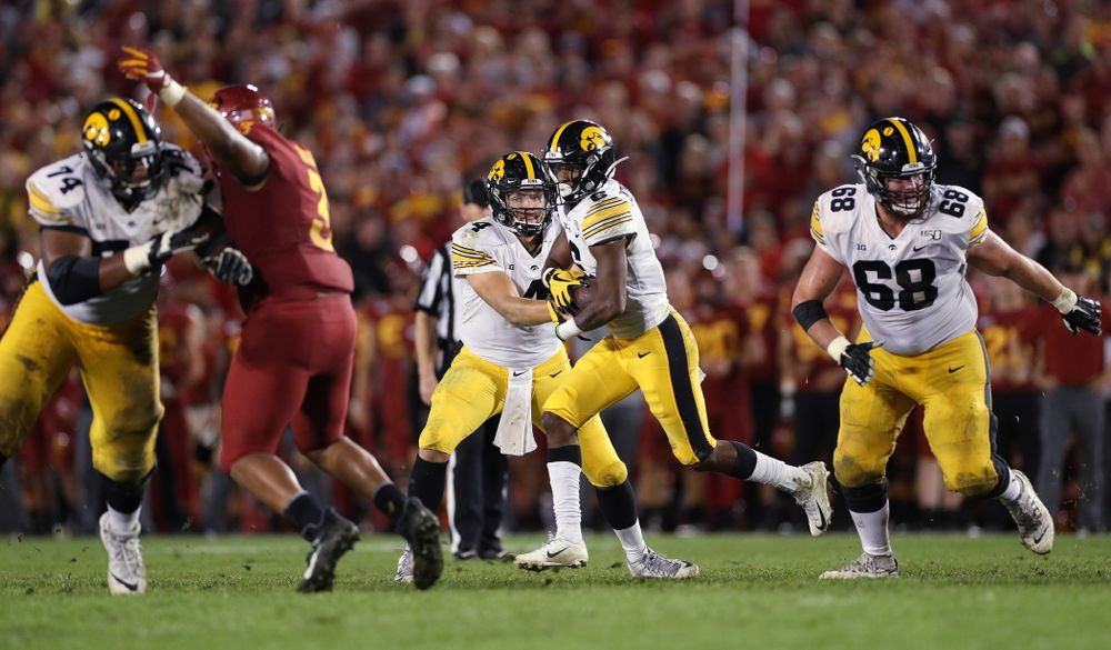 Iowa Hawkeyes wide receiver Ihmir Smith-Marsette (6) takes a handoff from quarterback Nate Stanley (4) against the Iowa State Cyclones Saturday, September 14, 2019 in Ames, Iowa. (Brian Ray/hawkeyesports.com)