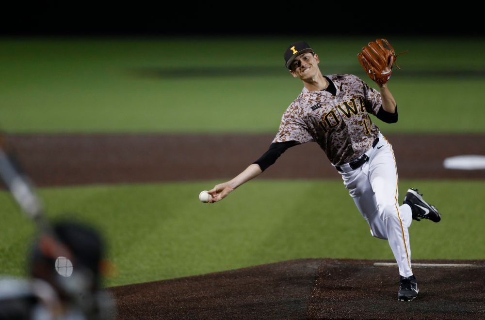 Iowa Hawkeyes pitcher Nick Nelsen (12) against Oklahoma State Friday, May 4, 2018 at Duane Banks Field. (Brian Ray/hawkeyesports.com)