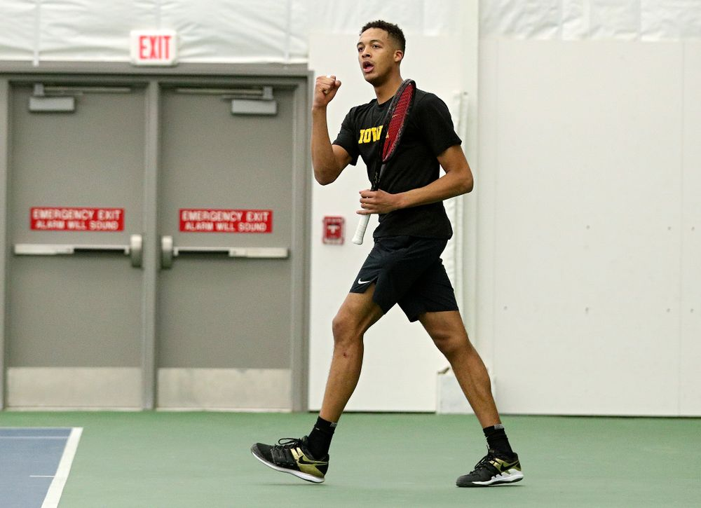 Iowa's Oliver Okonkwo celebrates after winning his singles match at the Hawkeye Tennis and Recreation Complex in Iowa City on Friday, February 14, 2020. (Stephen Mally/hawkeyesports.com)