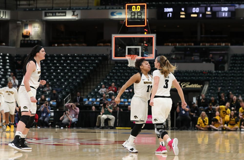 Iowa Hawkeyes guard Makenzie Meyer (3), guard Tania Davis (11), and forward Megan Gustafson (10) against the Indiana Hoosiers in the quarterfinals of the Big Ten Tournament Friday, March 8, 2019 at Bankers Life Fieldhouse in Indianapolis, Ind. (Brian Ray/hawkeyesports.com)