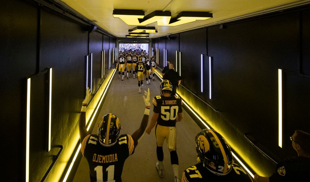 The Iowa Hawkeyes take the field in their new home tunnel before their game against the Miami RedHawks Saturday, August 31, 2019 at Kinnick Stadium in Iowa City. (Brian Ray/hawkeyesports.com)