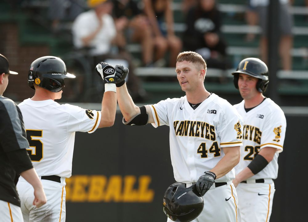 Iowa Hawkeyes outfielder Robert Neustrom (44) fist bumps catcher Tyler Cropley (5) after hitting a three run home run against the Oklahoma State Cowboys Saturday, May 5, 2018 at Duane Banks Field. (Brian Ray/hawkeyesports.com)