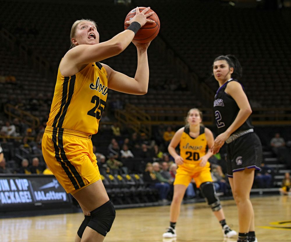 Iowa forward/center Monika Czinano (25) eyes the basket before making a bucket during the third quarter of their game against Winona State at Carver-Hawkeye Arena in Iowa City on Sunday, Nov 3, 2019. (Stephen Mally/hawkeyesports.com)