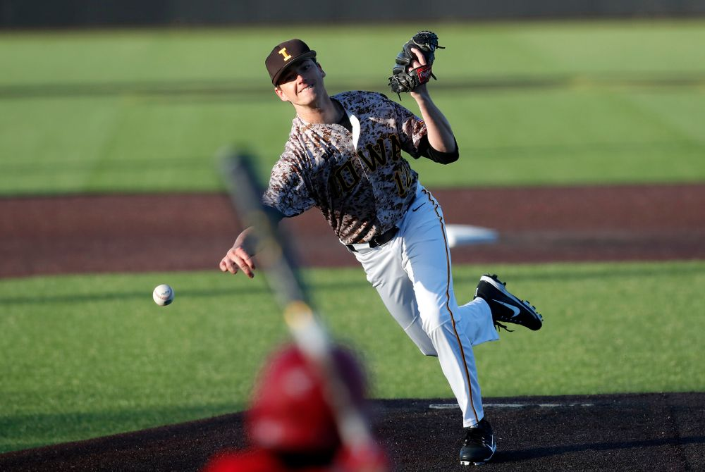 Iowa Hawkeyes pitcher Nick Nelsen (12) against the Ohio State Buckeyes Saturday, April 7, 2018 at Duane Banks Field. (Brian Ray/hawkeyesports.com)