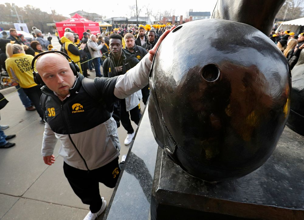 Iowa Hawkeyes fullback Brady Ross (36) touches the helmet on the Nile Kinnick statue before their game at Kinnick Stadium in Iowa City on Saturday, Nov 23, 2019. (Stephen Mally/hawkeyesports.com)