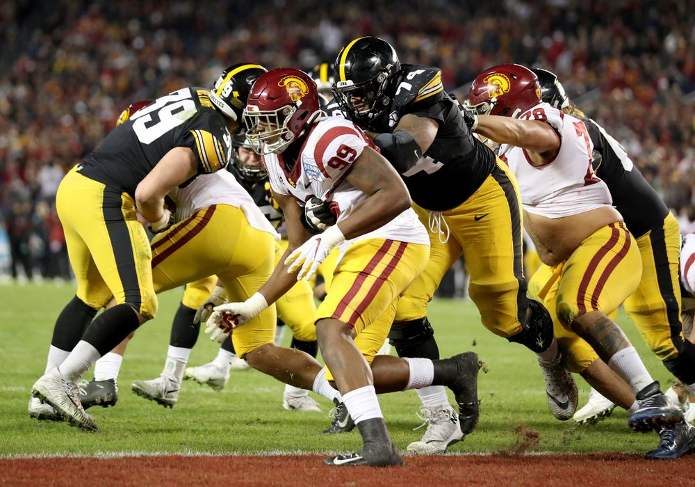 Iowa Hawkeyes offensive lineman Tristan Wirfs (74) blocks as running back Tyler Goodson (15) scores against USC in the Holiday Bowl Friday, December 27, 2019 at San Diego Community Credit Union Stadium.  (Brian Ray/hawkeyesports.com)