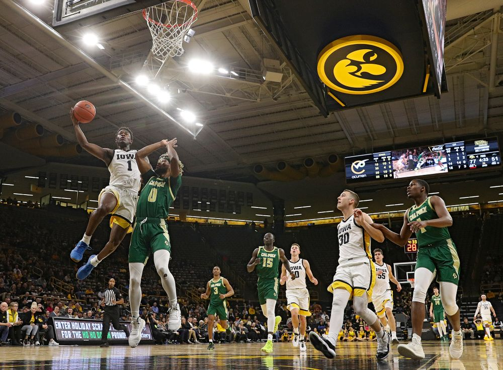 Iowa Hawkeyes guard Joe Toussaint (1) puts up a shot during the second half of their game at Carver-Hawkeye Arena in Iowa City on Sunday, Nov 24, 2019. (Stephen Mally/hawkeyesports.com)