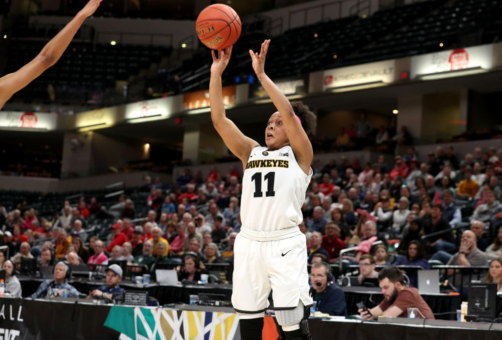 Iowa Hawkeyes guard Tania Davis (11) knocks down a three point basket against the Rutgers Scarlet Knights in the semi-finals of the Big Ten Tournament Saturday, March 9, 2019 at Bankers Life Fieldhouse in Indianapolis, Ind. (Brian Ray/hawkeyesports.com)