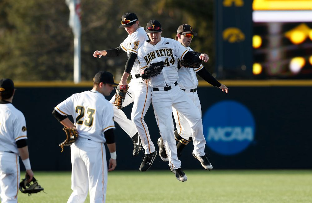 Iowa Hawkeyes outfielder Ben Norman (9), outfielder Robert Neustrom (44), and outfielder Justin Jenkins (6) against Northern Illinois Tuesday, April 17, 2018 at Duane Banks Field. (Brian Ray/hawkeyesports.com)