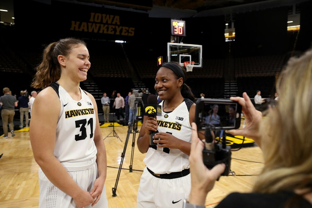 Iowa Hawkeyes forward/center Paula Valino Ramos (31) and guard Zion Sanders (24) during the team's annual media day Wednesday, October 31, 2018 at Carver-Hawkeye Arena. (Brian Ray/hawkeyesports.com)