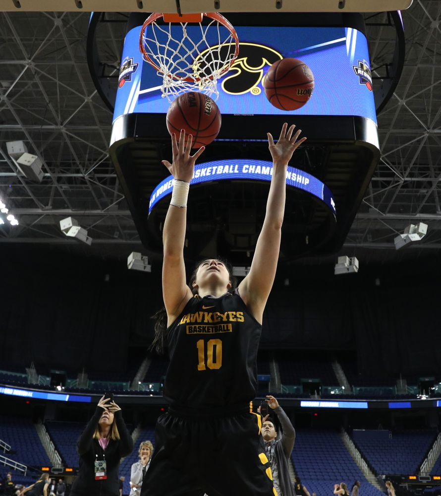 Iowa Hawkeyes forward Megan Gustafson (10) does the Mikan Drill the ESPN Crew following practice for their Sweet 16 matchup against NC State Friday, March 29, 2019 at the Greensboro Coliseum in Greensboro, NC.(Brian Ray/hawkeyesports.com)