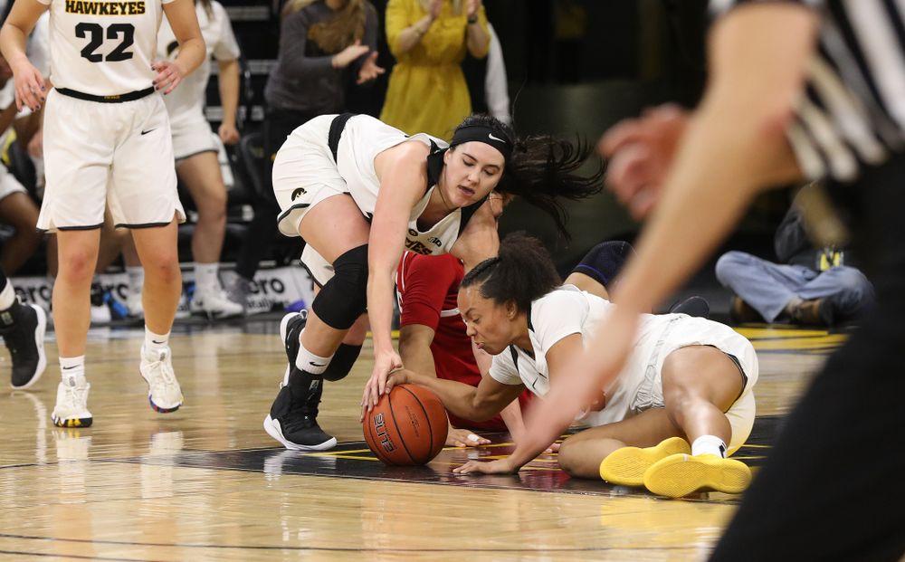 Iowa Hawkeyes forward Megan Gustafson (10) and guard Alexis Sevillian (5) against the Rutgers Scarlet Knights Wednesday, January 23, 2019 at Carver-Hawkeye Arena. (Brian Ray/hawkeyesports.com)