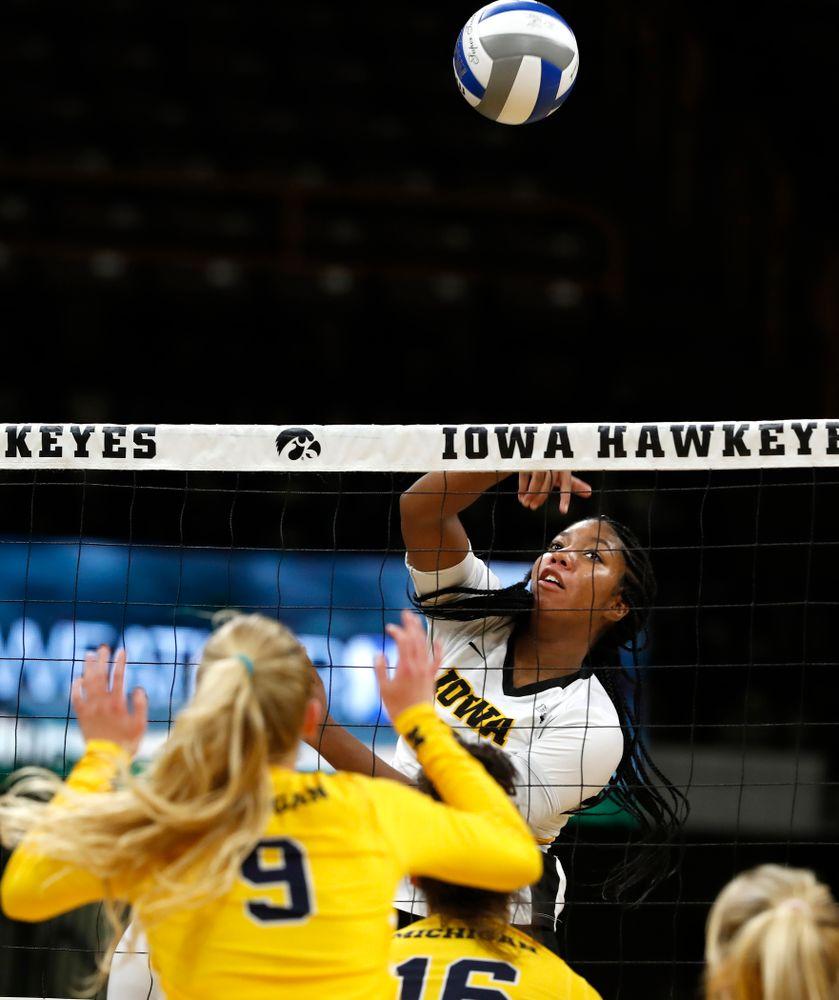 Iowa Hawkeyes middle blocker Amiya Jones (9) against the Michigan Wolverines Sunday, September 23, 2018 at Carver-Hawkeye Arena. (Brian Ray/hawkeyesports.com)