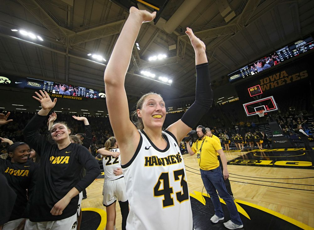 Iowa Hawkeyes forward Amanda Ollinger (43) waves to the crowd after their double overtime win at Carver-Hawkeye Arena in Iowa City on Sunday, January 12, 2020. (Stephen Mally/hawkeyesports.com)