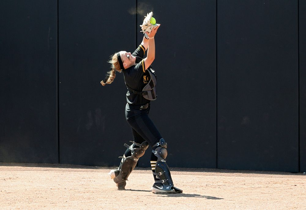 Iowa catcher Abby Lien (9) pulls in a pop up for an out during the fourth inning of their game against Ohio State at Pearl Field in Iowa City on Saturday, May. 4, 2019. (Stephen Mally/hawkeyesports.com)