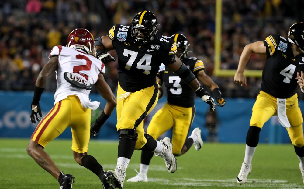 Iowa Hawkeyes offensive lineman Tristan Wirfs (74) blocks for wide receiver Tyrone Tracy Jr. (3) on his way to a touchdown against USC in the Holiday Bowl Friday, December 27, 2019 at San Diego Community Credit Union Stadium.  (Brian Ray/hawkeyesports.com)