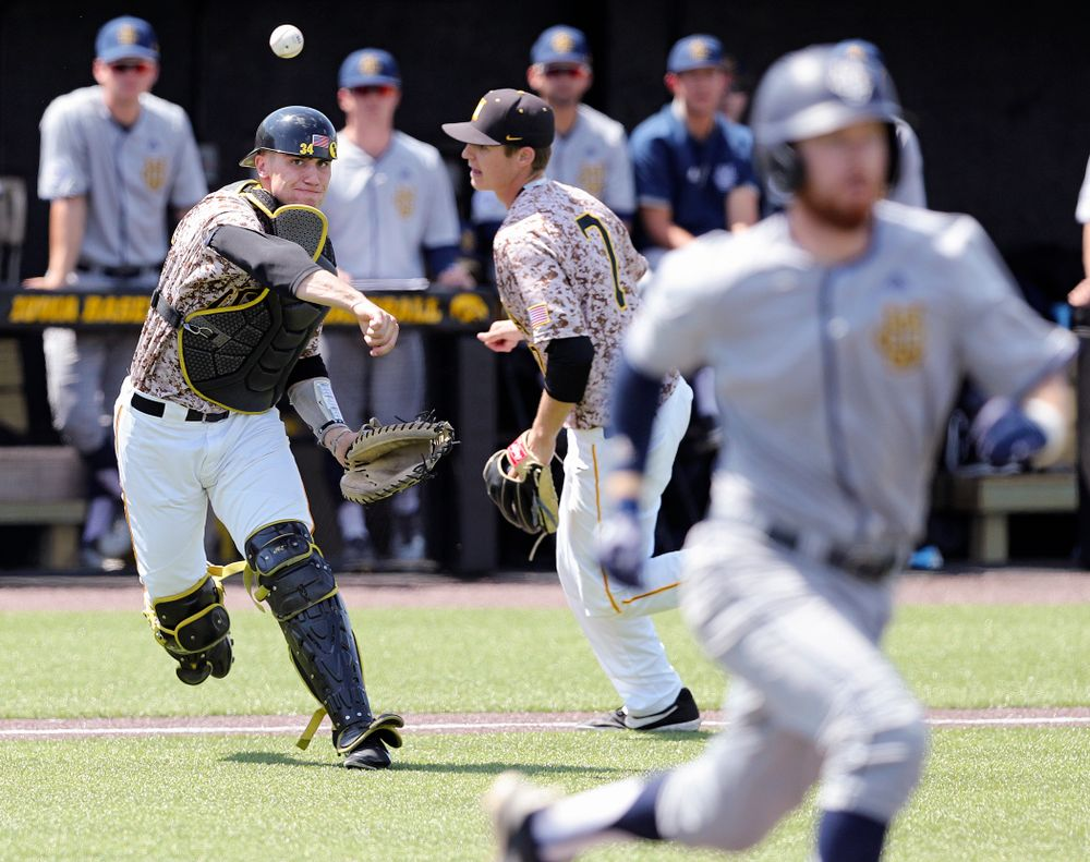 Iowa Hawkeyes catcher Austin Martin (34) throws to first for an out after fielding a bunt during the third inning of their game against UC Irvine at Duane Banks Field in Iowa City on Sunday, May. 5, 2019. (Stephen Mally/hawkeyesports.com)