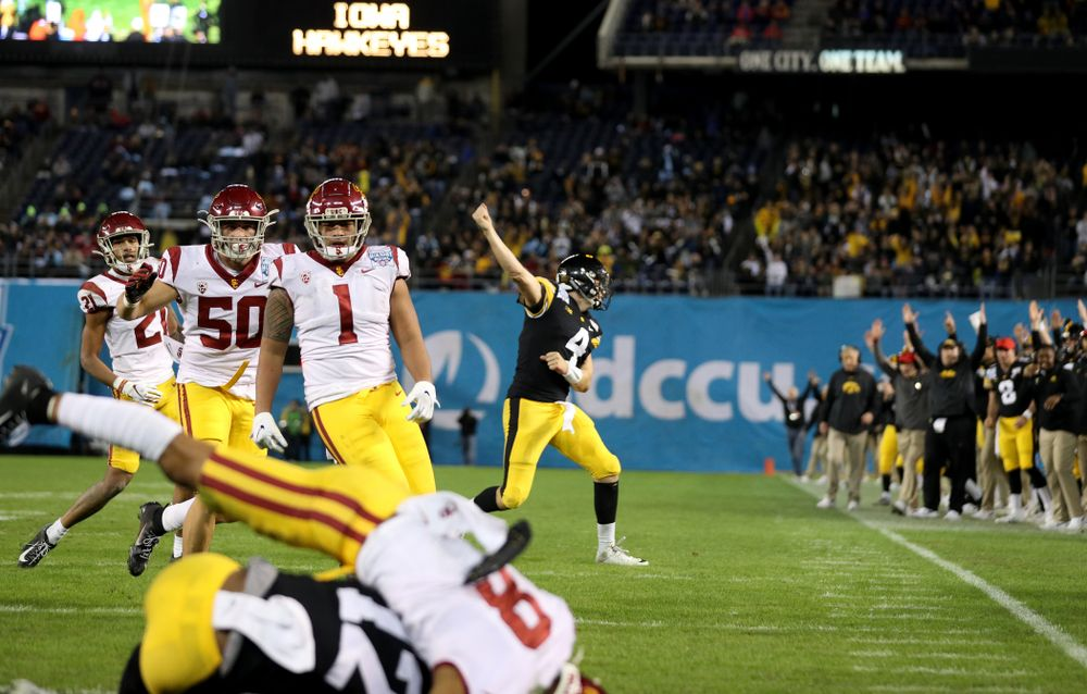 Iowa Hawkeyes quarterback Nate Stanley (4) celebrates a touchdown pass against USC in the Holiday Bowl Friday, December 27, 2019 at San Diego Community Credit Union Stadium.  (Brian Ray/hawkeyesports.com)