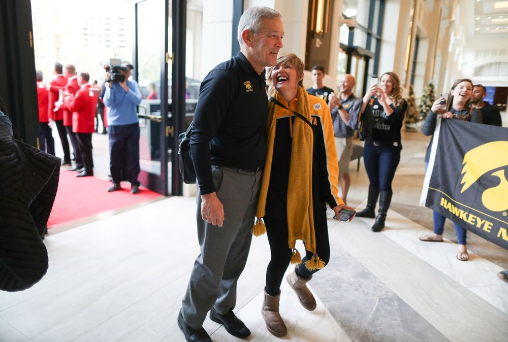 Iowa Hawkeyes head coach Kirk Ferentz takes photos with fans after arriving in San Diego, CA Saturday, December 21, 2019 for the Holiday Bowl. (Brian Ray/hawkeyesports.com)
