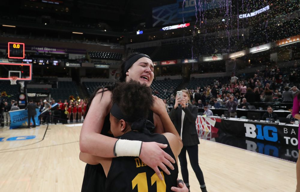 Iowa Hawkeyes forward Megan Gustafson (10) hugs guard Tania Davis (11) following their win against the Maryland Terrapins Sunday, March 10, 2019 at Bankers Life Fieldhouse in Indianapolis, Ind. (Brian Ray/hawkeyesports.com)