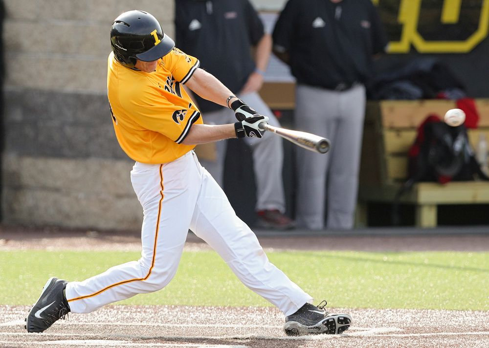Iowa Hawkeyes designated hitter Austin Martin (34) hits an RBI single during the third inning of their game against Northern Illinois at Duane Banks Field in Iowa City on Tuesday, Apr. 16, 2019. (Stephen Mally/hawkeyesports.com)